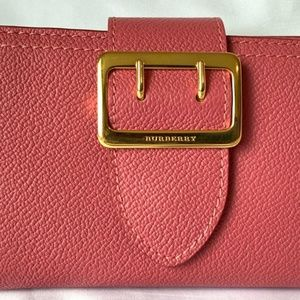 Wallet that is in salmon pink color